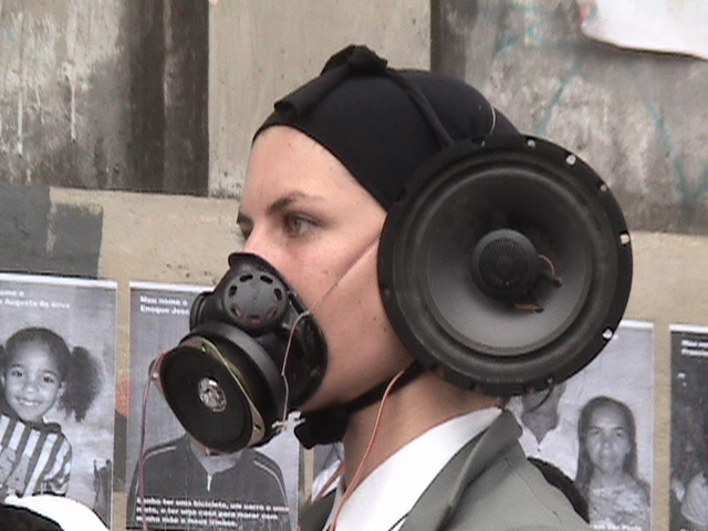 Veridiana Zurita with Pharmakon performance group in front of the squatted building at Prestes Maia Avenue, in São Paulo (2004). It was one of several attempts to bring attention to the condition of 468 families being evicted due to a process of gentrification conducted in the city centre.